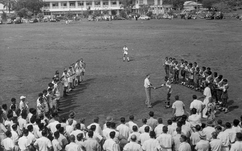 AR Driver at football match, oval near Darwin Hotel, c1946-1951