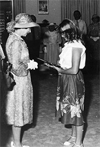 Peta Lynne Mann receiving the Royal Humane Society's Gold Medal for bravery from the Queen