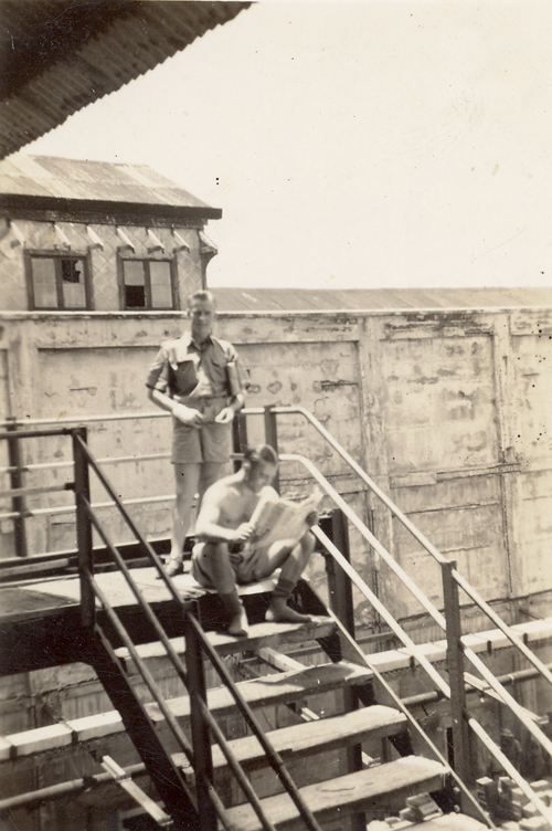 Field baker and butcher on steps of Vesteys Meatworks