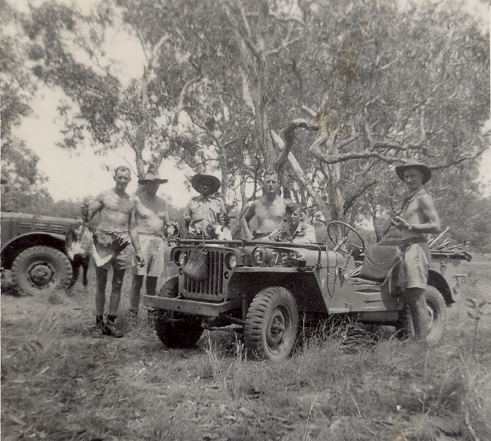 Hunting near Daly River, Charles Eaton sitting in the jeep, 1944