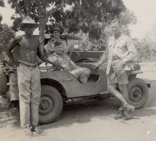 Charles Eaton, sitting in jeep, and Lt. Col, Dick Aises, standing at far  right, 1944