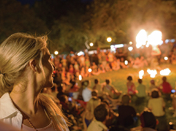 Lady and many others watching a fire performance